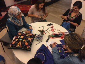 Making embroidery at the Hope Workshop