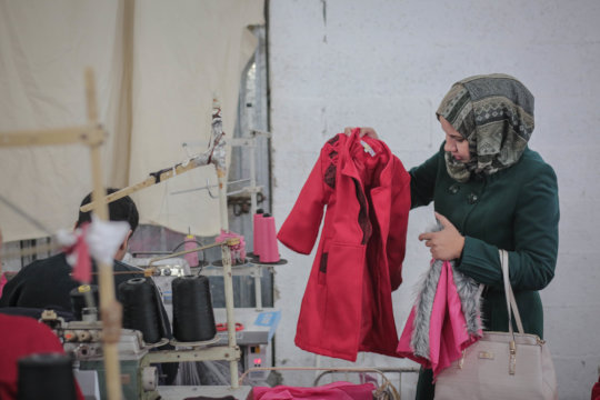 Making the jackets and clothes at factory in Gaza