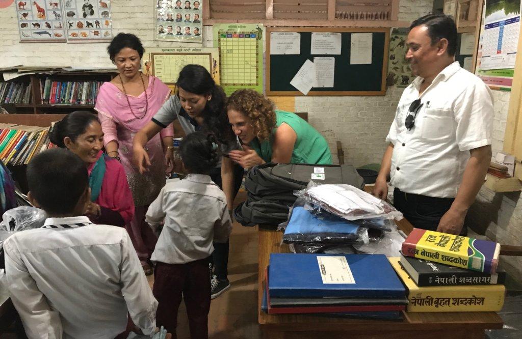 Distributing uniforms at Dattatraya School