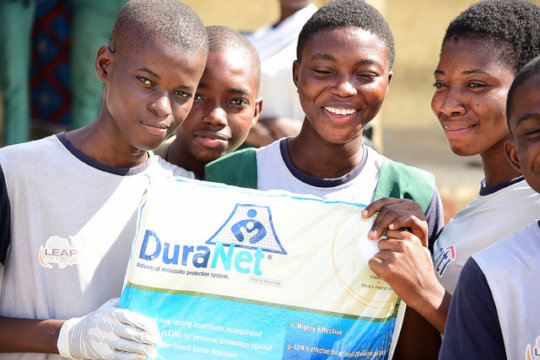 iLEAD students in action;handing out mosquito nets