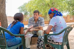 Felicia and James interviewing a community member