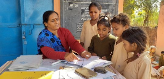 Manjula with children at School