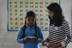 Girl child learning through GKP kits