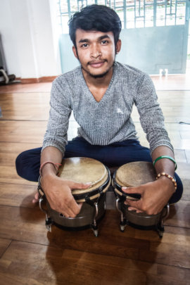 Nathann's happy to play the bongos!