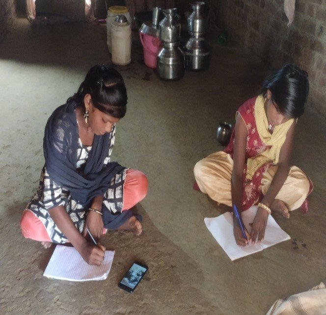 Children studying at home with mobile phones