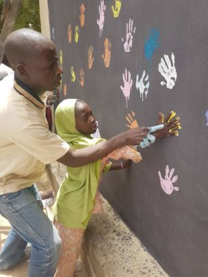 Children decorating the new child friendly spaces