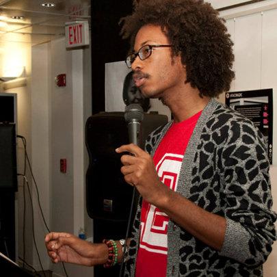 Malik speaking at an exhibit opening