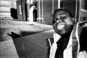 Self-Portrait In Front Of School