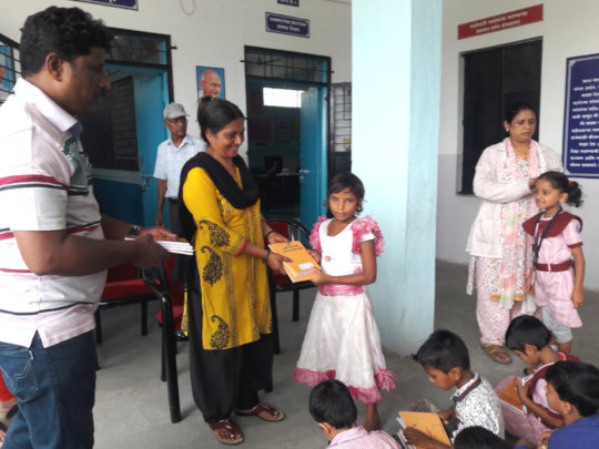 Distribution of Books and Notebooks in school