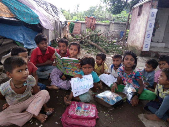 Street children studying at their locations