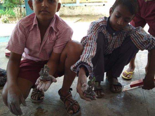 Making Clay Idol of Lord Ganesh