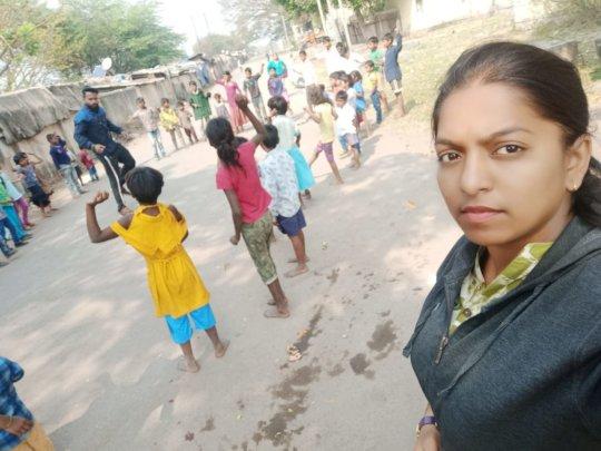 Sports teacher with children