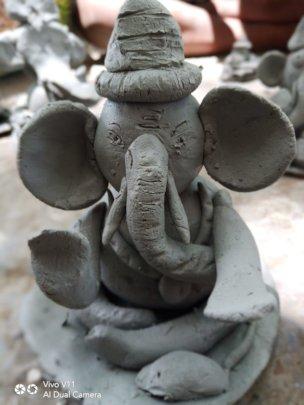 Lord Ganesha clay idol made by children