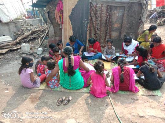 Teachers teaching street children in their areas
