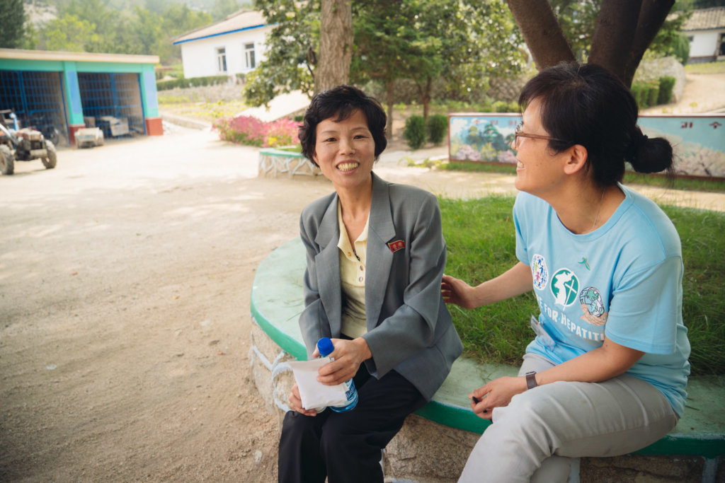 Dr Lee & patient on hep B treatment in Kaesong
