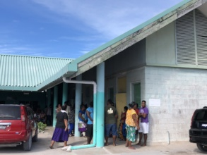 Patients waiting outside the clinic in Kiribati