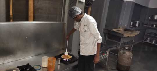Ravi taking charge in the kitchen
