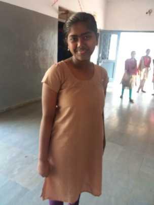 Sanjana wearing the dress she made.
