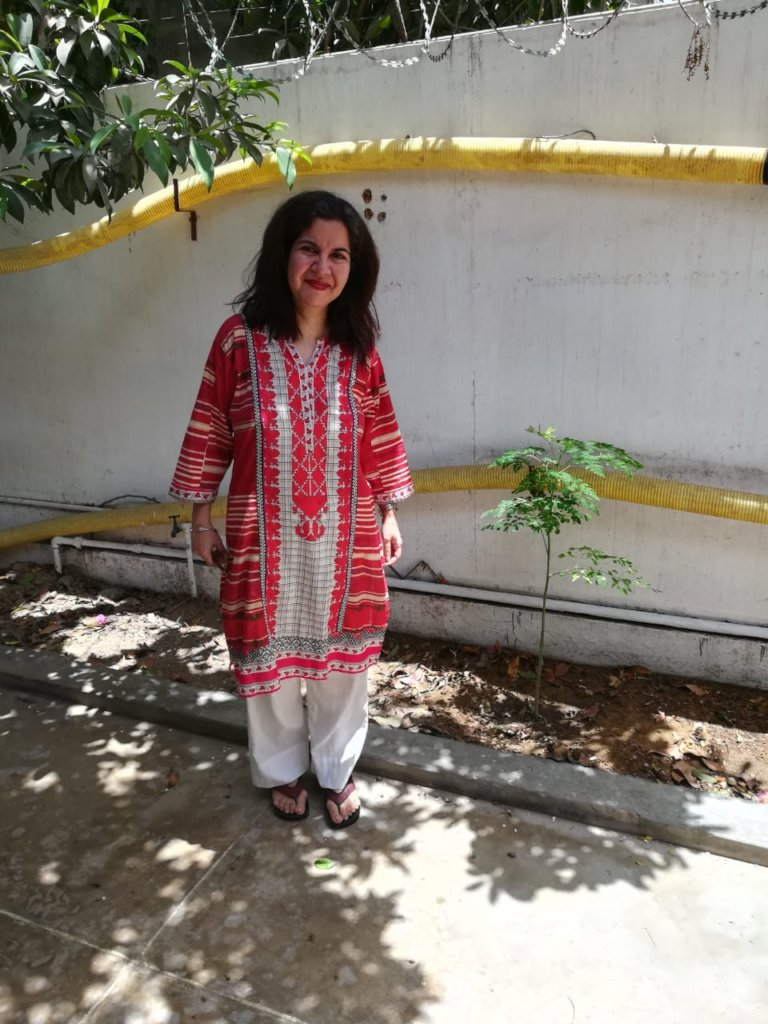 Ambreen with her moringa tree
