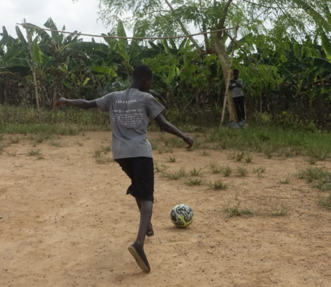 Playing football at the shelter