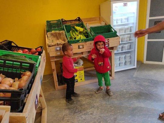 Two girls enjoying some fresh fruit