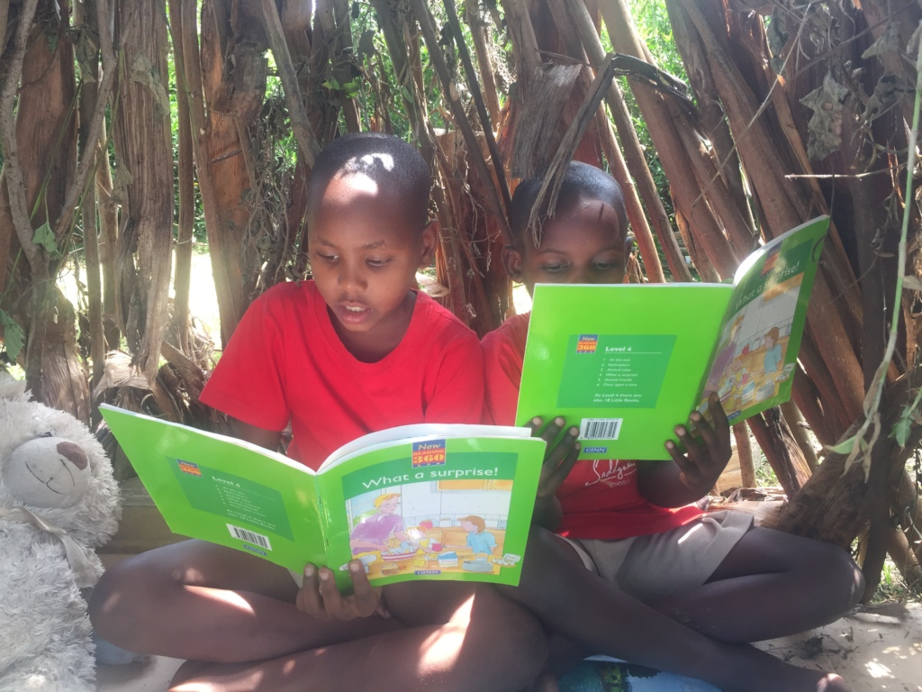 kids enjoying carefully selected books by OKAS