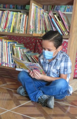 Elvin reading in StS school library