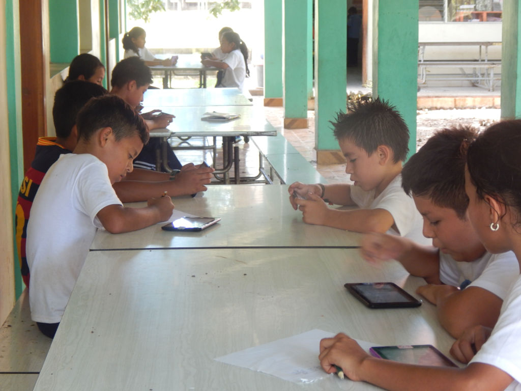 Children using technology at elementary school