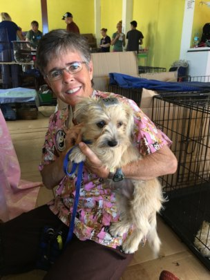 Volunteer Pam with one of our patients.