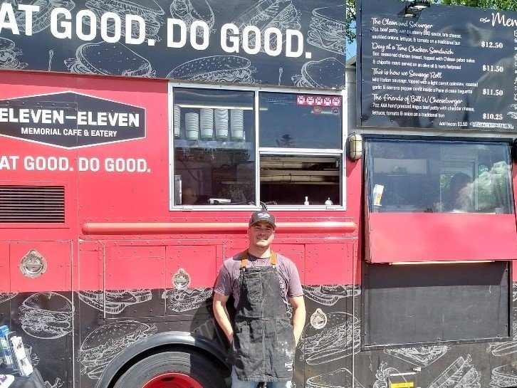 Rene in front of the Eleven-Eleven Food Truck