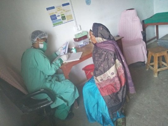 Dr Nahakul in his remote hospital in home-made PPE