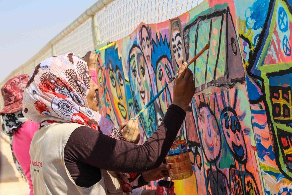 Paint murals with 300 Syrian Refugee children