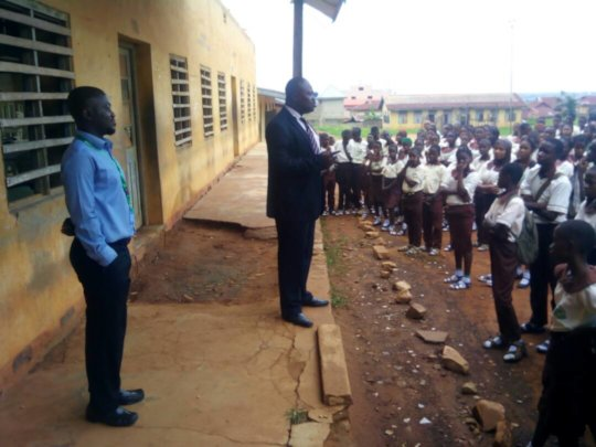 The school principal addressing his students