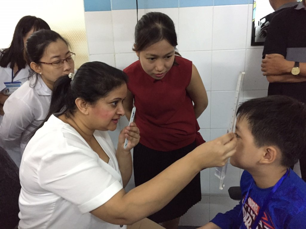 Orthoptist from UK examined a child for strabismus