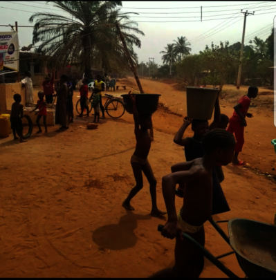Residents including children fetching water