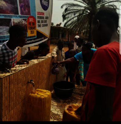 Rural dwellers fetching water from the platform