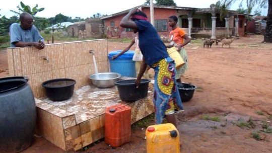 community dwellers seen fetching water