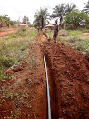 workers laying underground water extension pipes