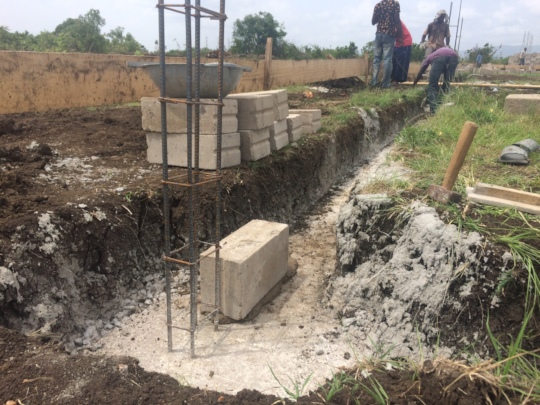 First foundation block being laid
