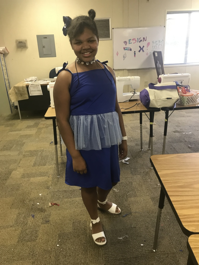 She designed and made her dress!