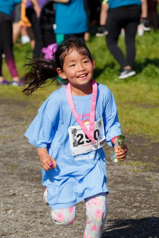 A young finisher at our annual Fun & Fitness Run