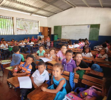Students in their new school and new desks