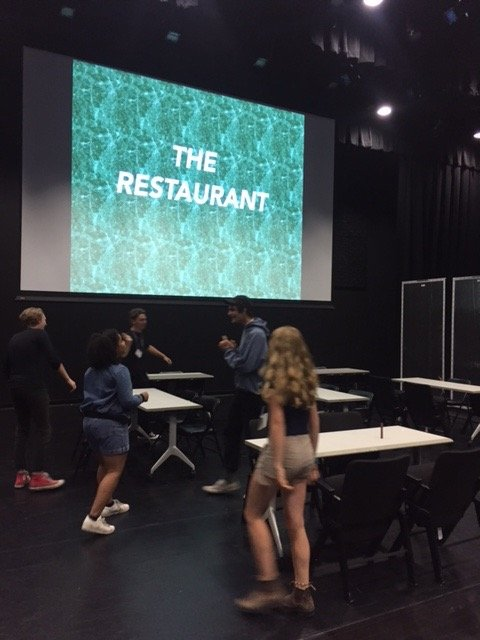 "Students setting up ""The Restaurant"" activity"