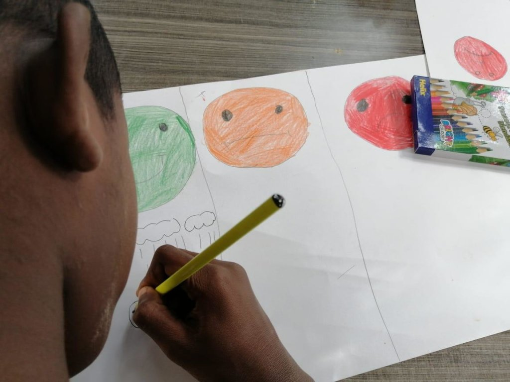 A child participating in an activity with TIPA