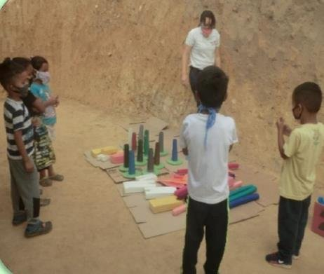 Merenciana and the children during an activity