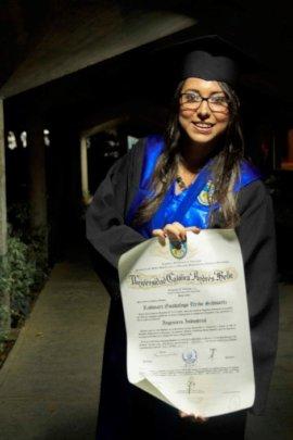 Rodmari holding her diploma