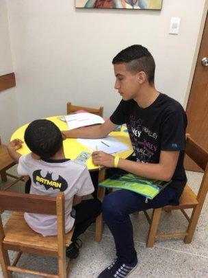 Moises testing a child during his internship