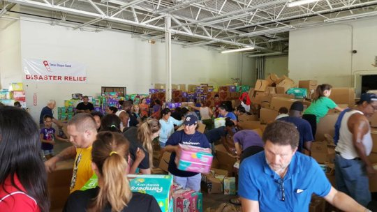 Volunteers working at Texas Diaper Bank warehouse