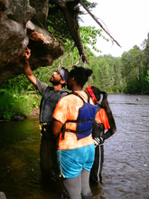 A guide shows campers a natural wonder