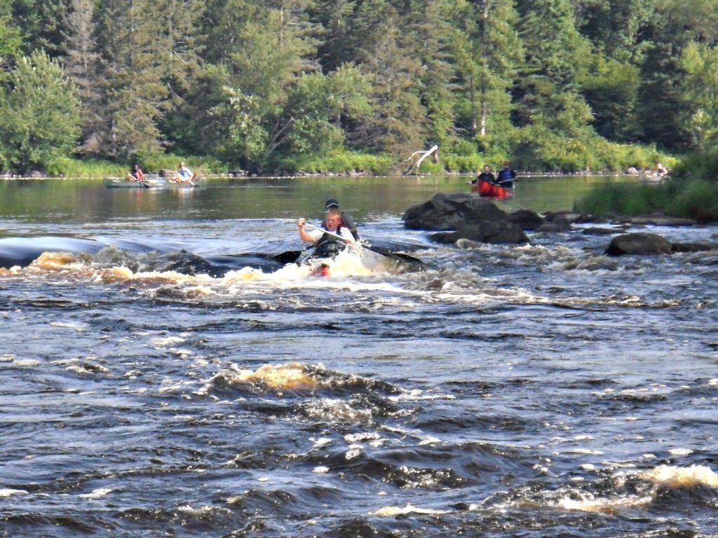 Paddling in whitewater rapids! Looks exciting!